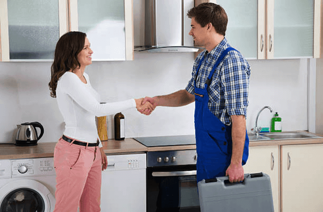 appliance repairman meeting customer